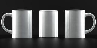 Maquetas de la taza en fondo negro Imágenes de archivo libres de regalías