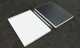 Maquetas del cuaderno en fondo concreto Imagenes de archivo
