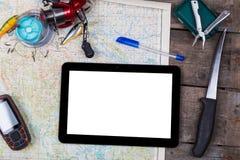 Maquette avec les articles de pêche et le navigateur sur la carte Images stock