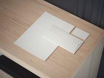 Maquette blanche d'affaires sur la table en bois rendu 3d Photo libre de droits