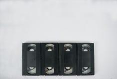 Maquette de bande vidéo en cassettes quatre sur les milieux blancs Photographie stock libre de droits