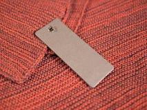 Maquette de prix à payer de label du blanc deux sur la laine Photographie stock