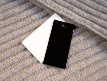 Maquette de prix à payer de label du blanc deux sur la laine Photographie stock libre de droits