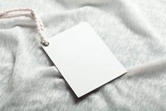Maquette de whie de blanc de label de tissu Photographie stock