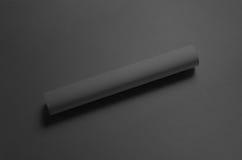 Maquette noire de l'affiche A3 - roulée Images libres de droits