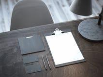 Maquette noire sur la table en bois rendu 3d Photographie stock libre de droits