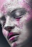 Maquillage argenté images libres de droits
