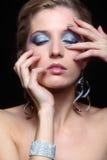 Maquillage brillant de visage de femme Images stock