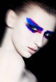 Maquillage créatif d'art de beauté sur le fond noir Photo stock
