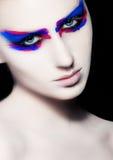 Maquillage créatif d'art de beauté sur le fond noir Images stock
