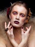 Maquillage de femme de beauté de Halloween Photographie stock libre de droits