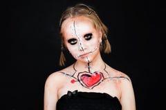 Maquillage de Halloween avec le coeur rouge Photographie stock