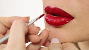 Maquillage rouge de lèvres banque de vidéos