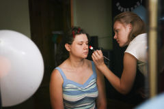 Maquillage for young bride. Getting young bride ready and making  up Stock Images
