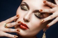 Maquillaje brillante de la cara Fotos de archivo