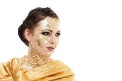 Maquillaje de la cara del oro Imagen de archivo