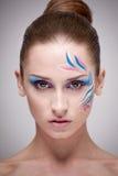 Maquillaje de la moda con arte de la cara. Fotos de archivo