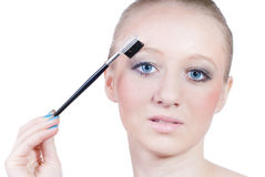 Maquillaje de la mujer joven hermosa aislada en blanco imagen de archivo libre de regalías