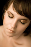 Maquillaje de oro Foto de archivo libre de regalías