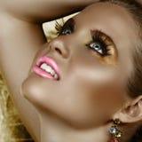 Maquillaje de oro de la fantasía Imágenes de archivo libres de regalías