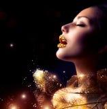 Maquillaje de oro de lujo Foto de archivo libre de regalías