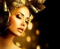 Maquillaje de oro del día de fiesta imagen de archivo