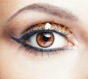 Maquillaje de oro del ojo Foto de archivo