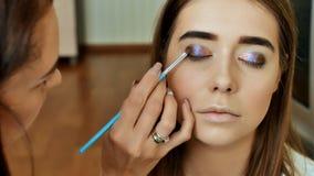Maquillaje del ojo Maquillaje hermoso del brillo de los ojos Detalle del maquillaje del día de fiesta Párpados de los ojos Fotografía de archivo libre de regalías