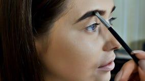 Maquillaje del ojo Maquillaje hermoso del brillo de los ojos Detalle del maquillaje del día de fiesta Párpados de los ojos Imagen de archivo