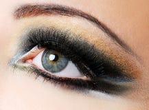 Maquillaje moderno de oro-marrón de la creatividad Foto de archivo
