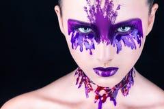 Maquillaje púrpura imagenes de archivo