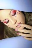 Maquillaje y color rojo del clavo. Imagen de archivo libre de regalías
