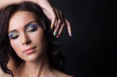 Maquillaje y manicura coloridos profesionales Foto de archivo libre de regalías