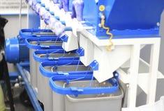 Maquinaria agrícola, dispositivos para a dosagem na exposição Imagens de Stock