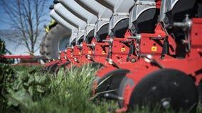 Maquinaria agrícola na grama verde Imagens de Stock Royalty Free