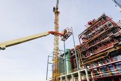 Maquinaria e trabalhador hidráulicos Fotos de Stock