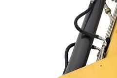 Maquinaria hidráulica da escavadora isolada no branco fotografia de stock