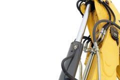 Maquinaria hidráulica de la niveladora aislada en blanco Imagen de archivo