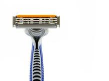 Maquinilla de afeitar aislada en blanco Foto de archivo