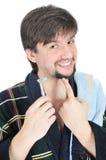 Maquinilla de afeitar feliz del asimiento del hombre Imagen de archivo