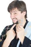 Maquinilla de afeitar sonriente del asimiento del hombre Imagen de archivo