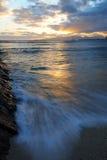 Marée de coucher du soleil Photos libres de droits