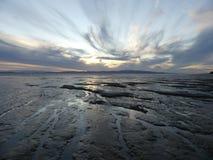 Marée inférieure au coucher du soleil Photographie stock