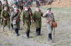 Mar�hing Russian soldiers-reenactors. Royalty Free Stock Photos