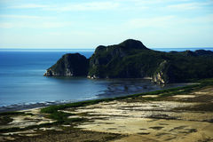 Mar, arena, e isla Imagenes de archivo