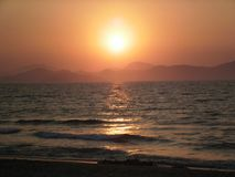Mar com por do sol Imagem de Stock Royalty Free