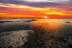 Mar congelado no por do sol imagem de stock royalty free