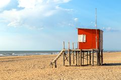 Beach scene. Red lifeguard tower in foreground. Atlantic coast. Mar de las Pampas. Argentina. Mar de las Pampas. Argentina. Beach scene. Red lifeguard tower in royalty free stock images