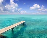 Mar de madera Formentera de la turquesa del embarcadero de Illeta Foto de archivo libre de regalías