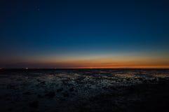 Mar de Wadden en la noche Fotos de archivo